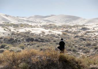 man in the desert alone