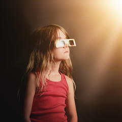 Child Looking Up at Solar Eclipse