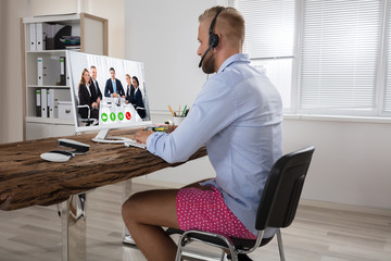 Businessman Attending Video Conference On Computer