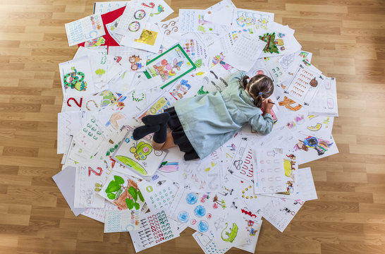 Student lays faces down over her whole year homework
