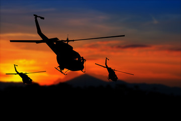 soldier silhouette in rappelling climb down from helicopter on sunset with copy space add text