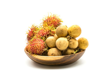 Fototapete - Fresh Rambutans and Longkongs in a wooden bowl