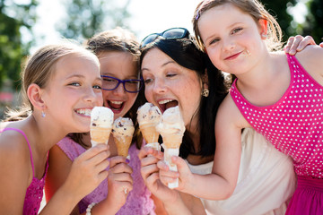 Mother and children sharing ice-cream. Fun and bonding.
