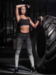 Powerful, attractive muscular girl engaged in crossfit, training