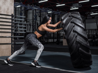 The girl is engaged in a CrossFit workout. The athlete pushes a