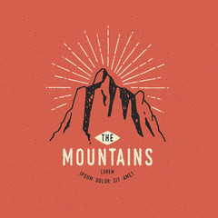 Hand Drawn mountains. Sketch illustration. Adventures logos isolated on red background. Vintage trendy labels. Vector illustration.