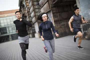 Young friends jogging outdoors