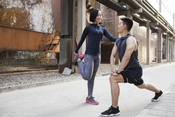 Young couple exercising outdoors