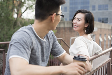 Cheerful young couple talking outdoors