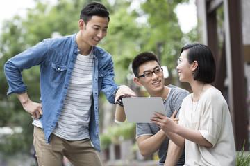 Confident designer team talking outdoors