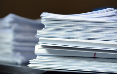 stack of paper files, documents