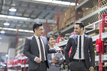 Business people talking in the factory