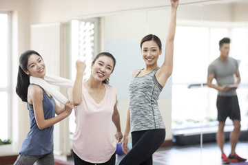 Happy young women cheering
