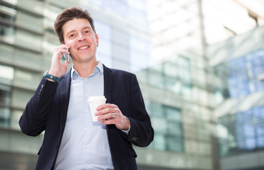 Businessman talking about work on the mobile phone