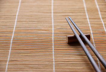 Wooden chopsticks on Bamboo table,Japanese and Chinese food equipment,with copy space