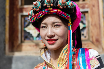 A girl dressed in national costume in Badan County,Sichuan province,China