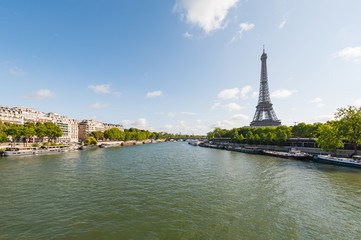 Paris and Eiffel tower with river Seine in the foreground on a sunny day, France