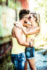 Portrait of young fashionable couple in love, joyful smiling expressions with heads together. Concept urban Loving Couple