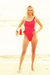 Young woman with volleyball ball on beach
