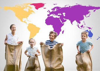 Kids in sack race in front of colorful world map