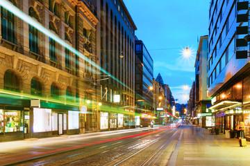 Helsinki, Finland. Tram Departs From A Stop On Street Aleksanterinkatu In Helsinki.