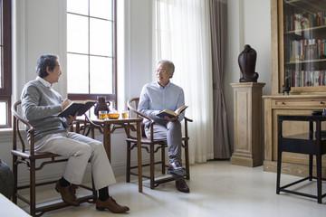 Senior men reading books
