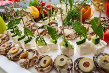 Cheese, meat and fruits served during food catering