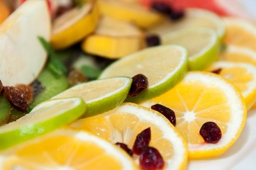 Fresh fruit salad with mixed fruits served on a plate