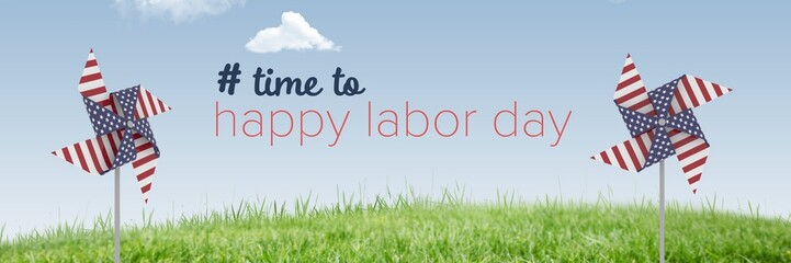 Happy labor day text and USA wind catchers in front of grass and
