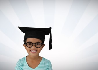 Girl with graduation hat and bright streaked background