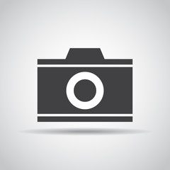 Camera icon with shadow on a gray background. Vector illustration