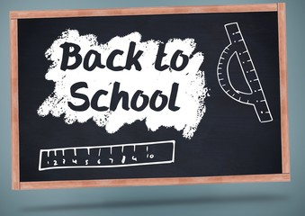 back to school on blackboard with chalk and rulers