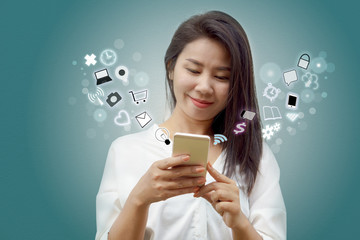 beautiful young Asian woman and smart phone connecting to internet with icon social media and modern technology background