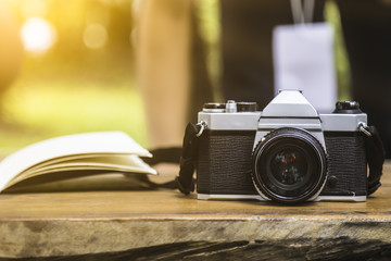 camera on wooden table outdoors garden background