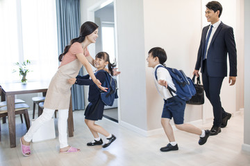 Happy children come back home from school