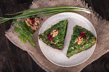 Top View of Persian Mixed herbs frittata with barberry and walnut Kuku and Zereshk