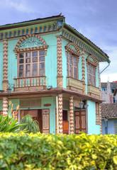 Colorful old corner house in the downtown plaza of Zaruma, El Oro, Ecuador