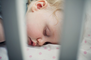 Baby asleep in a cot
