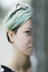 closeup of young woman with green pastel colors .