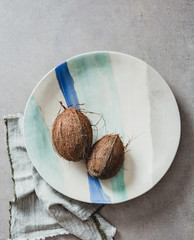 Artistic ceramic plate with coconuts