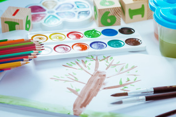 Children's drawing by paints. painting supplies