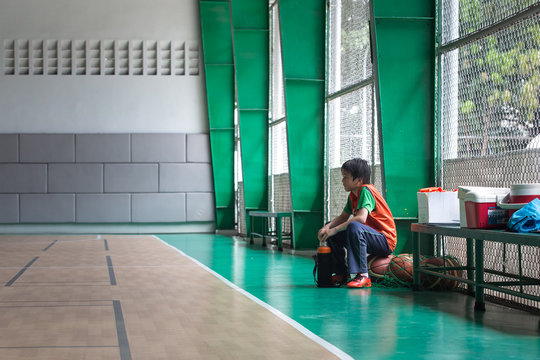 A young boy as a silent spectator in the sidelines.