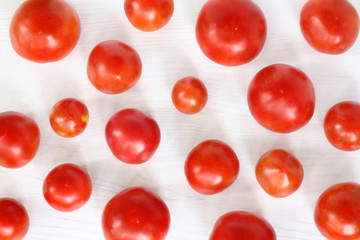 Vegetable background/ Red tomatoes scattered on the table top view