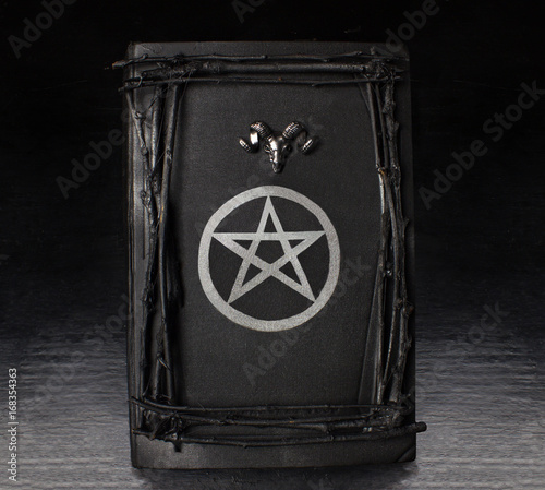Black Magic Book With Pentagram Symbol And Rams Head On Stock