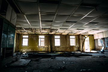 large ruined room with windows, control center room in abandoned factory