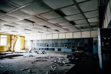 Abandoned industrial background, large ruined room with Iron cabinets