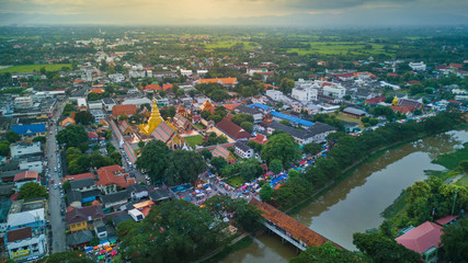 Aerial view lamphun city and People walking on lamphun walk street or night market. tourist attraction in lamphun