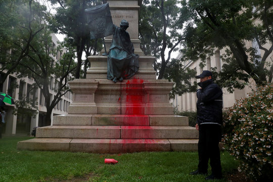 Red paint is seen splattered on the base of a statue of Confederate General Albert Pike during a demonstration calling for its removal in Washington
