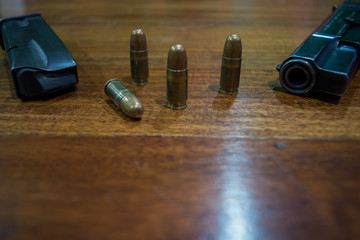 9mm gun on the table and some bullets
