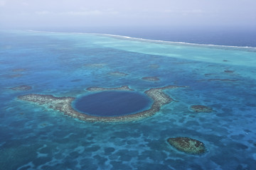 Aerial view of coral reefs and the Blue Hole, Lighthouse Atoll, Belize